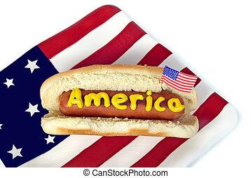 patriotic hot dog - Mustard on hot dog with flag.