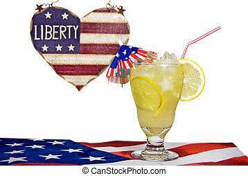 Patriotic Lemonade - Lemonade with star ice cubes on flag...