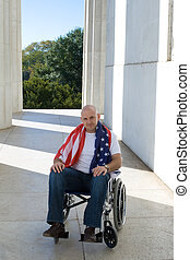 Patriotic Man in Wheelchair American Flag Blue Sky
