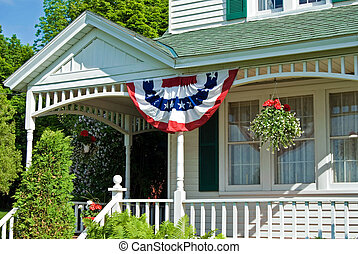 Patriotic Porch - Flag bunting on a country house porch.