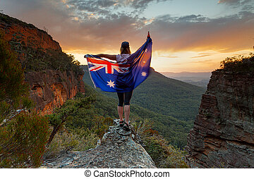 Patriotic woman holding Australian flag in Blue Mountains ...