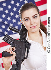patriotic woman with gun over american flag