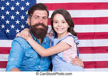 Patriotismt begins at home. Patriotic family showing patriotism on american flag decor. American patriotism. Patriotism and love for the homeland. Independence day