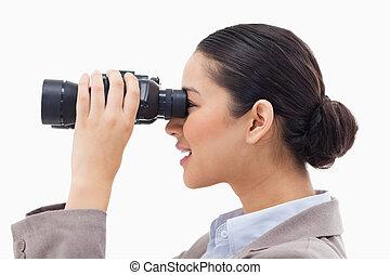 patrząc, kobieta interesu, lorneta, przez, widok budynku