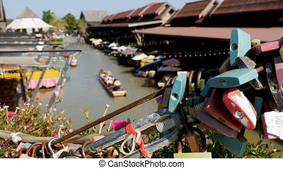 Pattaya Floating Market. Tourist Wooden Boat moving along the Water. Thailand, Asia