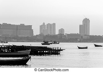 Pattaya Harbor and city view in the sunset: Black and white