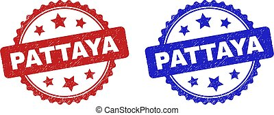 Rosette PATTAYA stamps. Flat vector grunge seal stamps with PATTAYA message inside rosette shape with stars, in blue and red color variants. Rubber imitations with scratched texture.