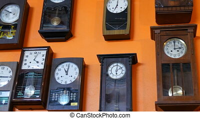 PATTAYA, THAILAND - Many different clock on wall. Old...