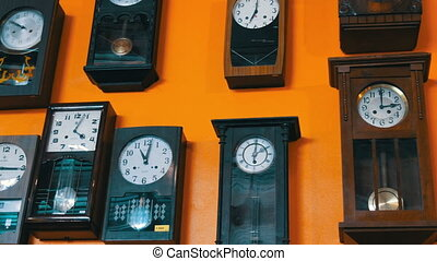 PATTAYA, THAILAND. Many different clock on wall. Old antique...
