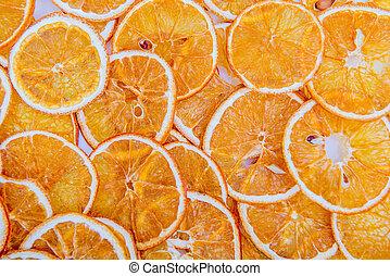 Pattern arranged with dried orange slices