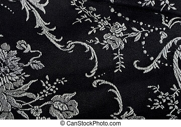 Pattern Background - Piece of black material with white...