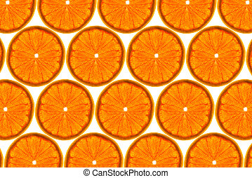 Pattern made from fresh grapefruit slices on a white background, overhead view, flatlay. Fruit background.