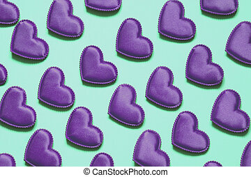 Pattern made of ultra violet hearts on blue. Heart in isometric style. Valentine's card. May be use for wrapping paper.