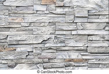 Pattern of decorative gray granite stone wall for background and texture
