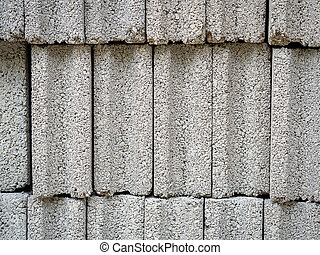 Pattern of grey concrete cement block bricks at construction site.