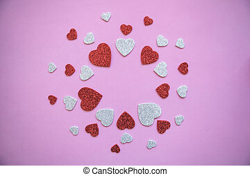 Pattern of many hearts on a pink background