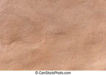 ocher wooden wall with peeling color