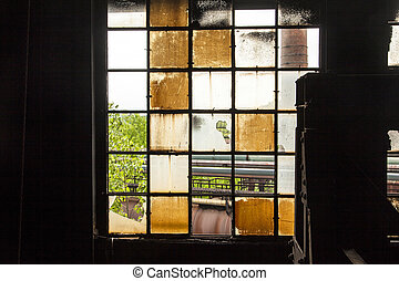 pattern of old broken industry window gives a harmonic background