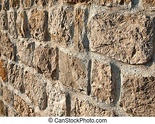 Pattern of old stone wall