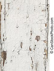 peeling color at an old wooden door
