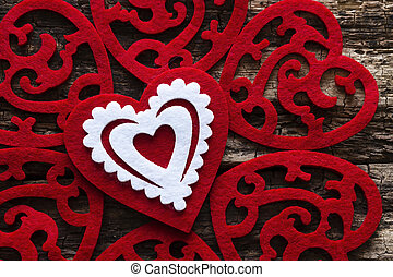 pattern of red hearts on a wooden background