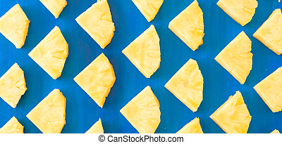 pattern of Sweet pineapple on blue background top view, flat lay