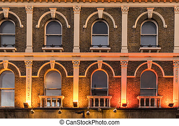 Pattern of windows in a old victorian building