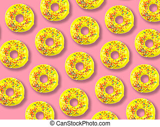 Pattern of yellow donuts on a pink background.
