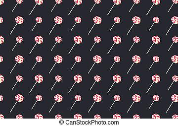Pattern sweet lollipops, candy on black background