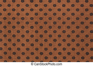 Pattern with big black polka dots on a brown use a background.