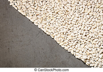 Pattern with white beans on grey background.