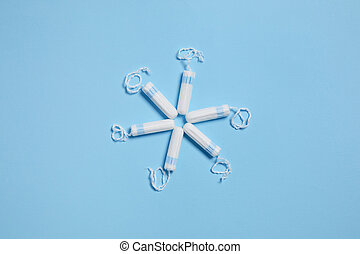 Pattern with white sanitary cotton tampons