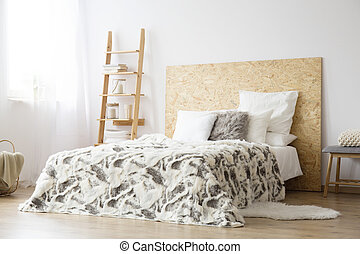 Patterned bedsheets on king-size bed
