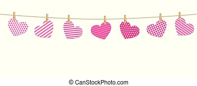 patterned hearts hang on a rope with clothespins