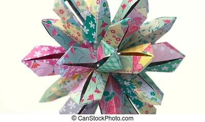 Patterned origami flower on white background. Amazing design...