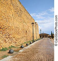 paved promenade along antique city walls in Ciudad Rodrigo,...