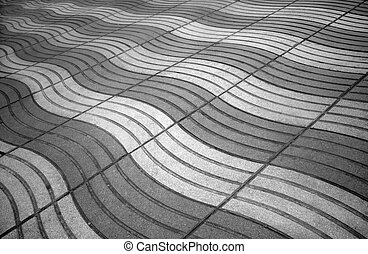 Paved sidewalk - Background of paved sidewalk in grayscale