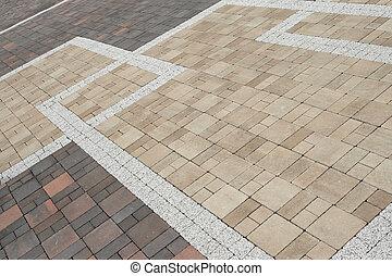 Sett blocks background texture. Tiled, colorful, decorative pavement.