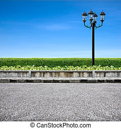 Pavement and street light on blue sky