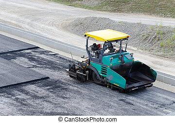 pavement machine ready for laying fresh asphalt or bitumen
