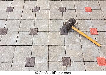pavement., marteau brique, caoutchoucs