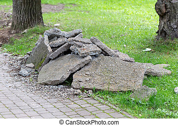 pavement renovation with rubble on the lawn