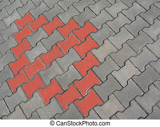 Pavement with red patterns