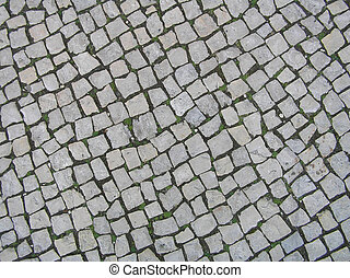 Detailed tiled cobbled pavement road surface texture close-up