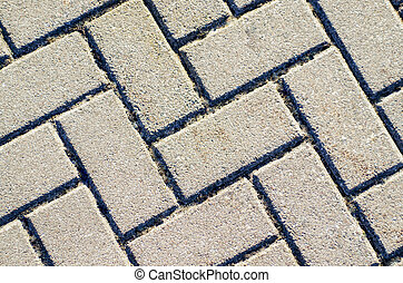 Pavement texture. Gray brick paving stones on a sidewalk