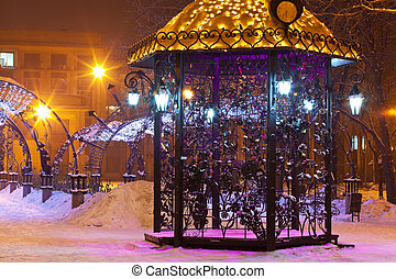 Pavilion in night winter city park