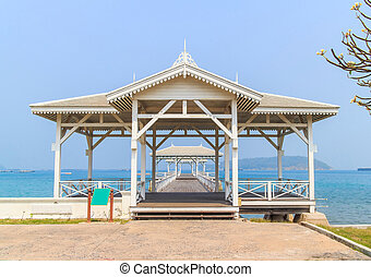 Pavilion made of wood in the middle of the sea.