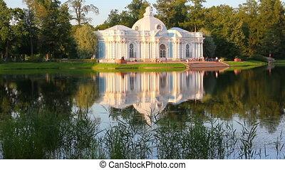 pavilion on lake in Pushkin park St. Petersburg Russia at sunset light