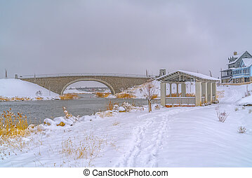 Pavilion on snowy shore of Oquirrh Lake in winter