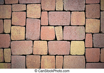 Background from paving stones, rectangular stones in red shades of color